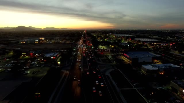 Busy Streets With City Lights and Sunset