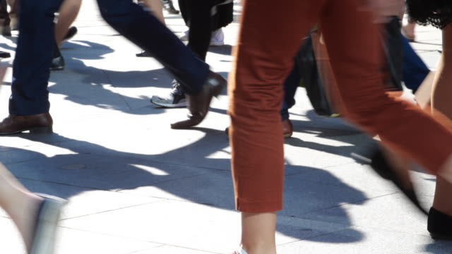busy summer street, walking feet. - busy morning stock videos & royalty-free footage