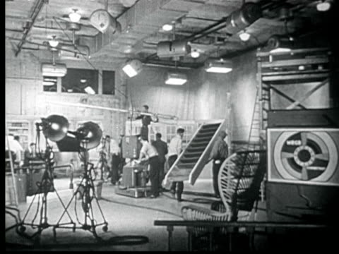 1945 b/w montage busy television studio. large early ge television camera. pull back to three performers in period costume being filmed. / new york city, usa / audio - fernsehserie stock-videos und b-roll-filmmaterial