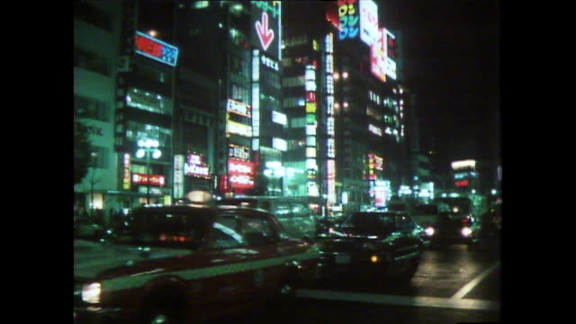 ws busy tokyo street with traffic and illuminated signs; 1981 - nightlife stock videos & royalty-free footage