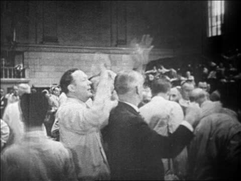 busy traders holding up hands on floor of stock exchange / newsreel - 1929 stock videos & royalty-free footage