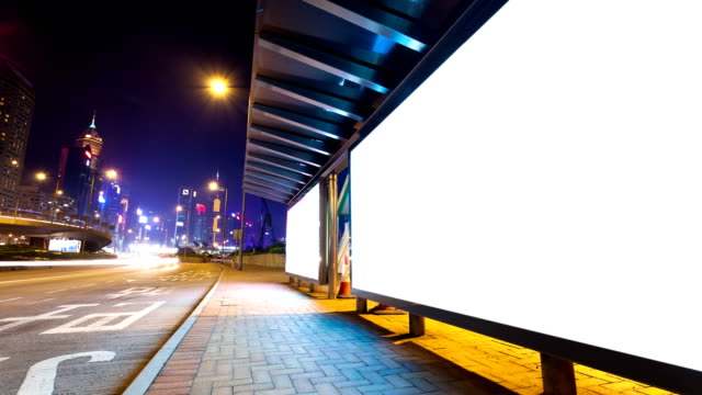 stockvideo's en b-roll-footage met busy traffic and bus in modern city hongkong at night,timelapse. - advertentie