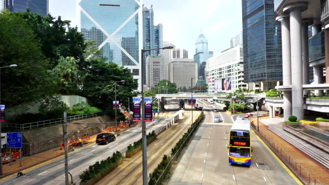 busy traffic and cityscape in modern city hong kong. - urban sprawl stock videos & royalty-free footage