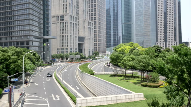 Busy traffic and modern buildings in shanghai,real time.