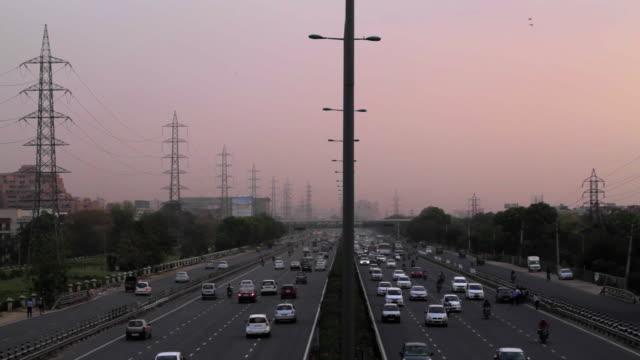 busy traffic at the delhi-gurgaon expressway, a part of national highway 8, at udyog vihar, gurgaon, haryana - motorway stock videos & royalty-free footage