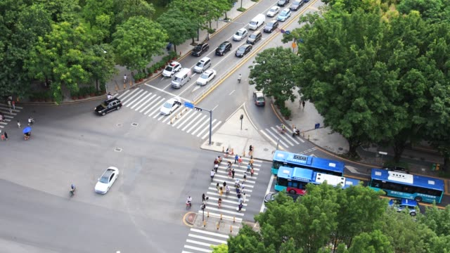 busy traffic at urban intersections/shenzhen,china - crossroad stock videos & royalty-free footage