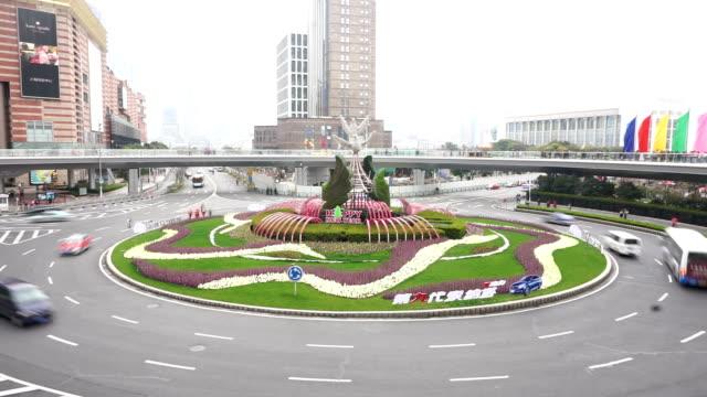 busy traffic circle and pedestrian walking on footbridge,time lapse. - footbridge stock videos & royalty-free footage