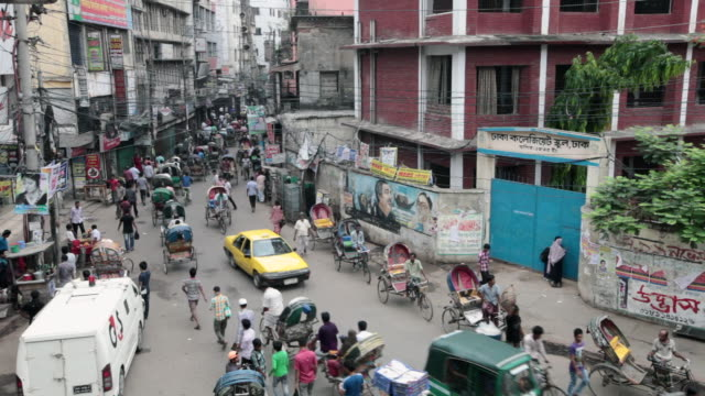 busy traffic in old dhaka, not far from the sadarghat boat terminal,  dhaka, bangladesh, indian sub-continent, asia - dhaka stock-videos und b-roll-filmmaterial