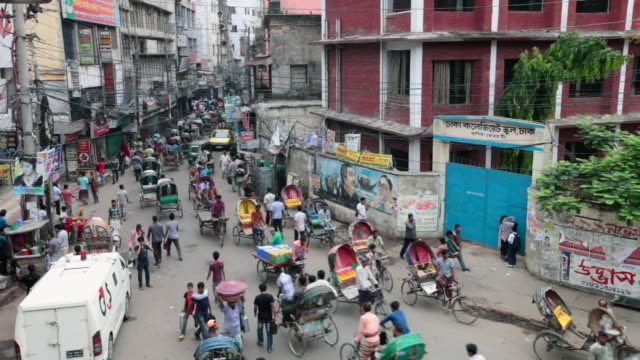 busy traffic in old dhaka, not far from the sadarghat boat terminal,  dhaka, bangladesh, indian sub-continent, asia (time-lapse video) - dhaka stock-videos und b-roll-filmmaterial