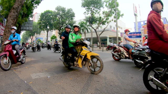 busy traffic in vietnam city - traditionally vietnamese stock videos & royalty-free footage