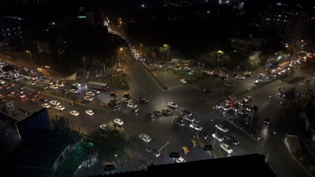 busy traffic intersection in mumbai - traffic stock videos & royalty-free footage