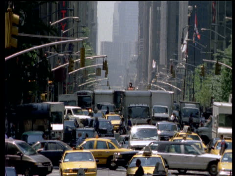 busy traffic junction - yellow taxi点の映像素材/bロール