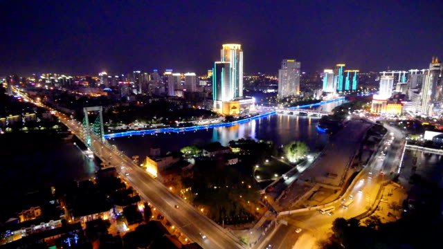 stockvideo's en b-roll-footage met busy traffic, modern buildings and urban cityscape in ningbo at night,time lapse. - ningbo
