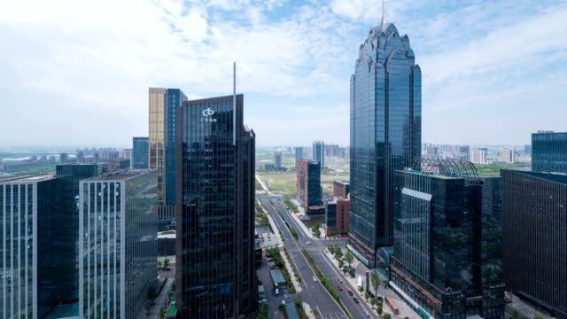 stockvideo's en b-roll-footage met busy traffic, modern buildings and urban cityscape in ningbo,time lapse. - ningbo