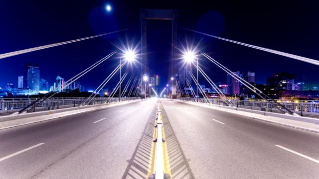 stockvideo's en b-roll-footage met busy traffic on bridge in modern city ningbo at night,time lapse. - ningbo