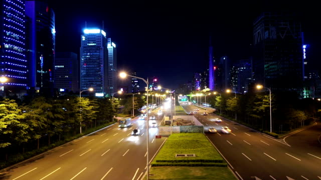 Busy traffic on multiple lane highway and buildings in shenzhen at night,time lapse.