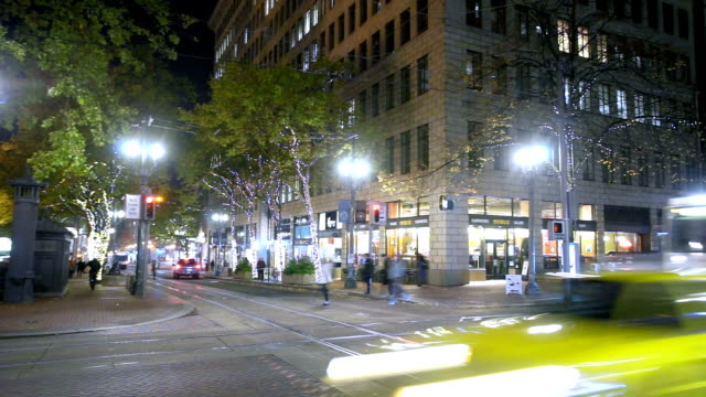 busy traffic on road in midtown of modern city timelapse - portland oregon stock videos & royalty-free footage