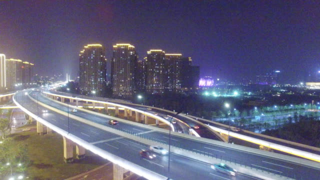 busy traffic on road intersection at night - hangzhou stock videos & royalty-free footage