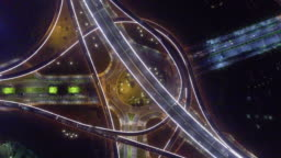 busy traffic on road intersection at night