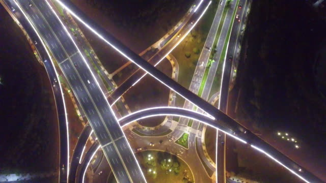busy traffic on road intersection at night - motorway stock videos & royalty-free footage