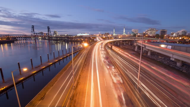 busy traffic on road,cityscape and skyline of portland. timelapse 4k - portland oregon street stock videos & royalty-free footage