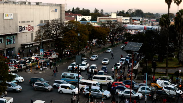 busy traffic on the roads of harare zimbabweans went to the polls yesterday to vote for a new president in the first election since robert mugabe who... - zimbabwe stock videos & royalty-free footage