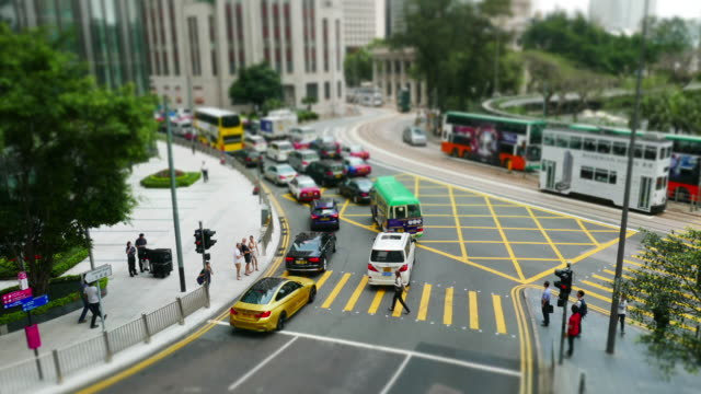 Busy traffic on urban street and modern buildings in hong kong