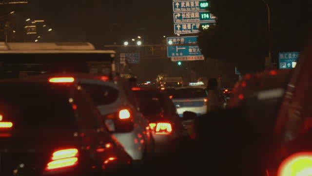 "busy traffic street scenes in wuhan, one year on from their coronavirus lockdown - ""bbc news"" stock videos & royalty-free footage"