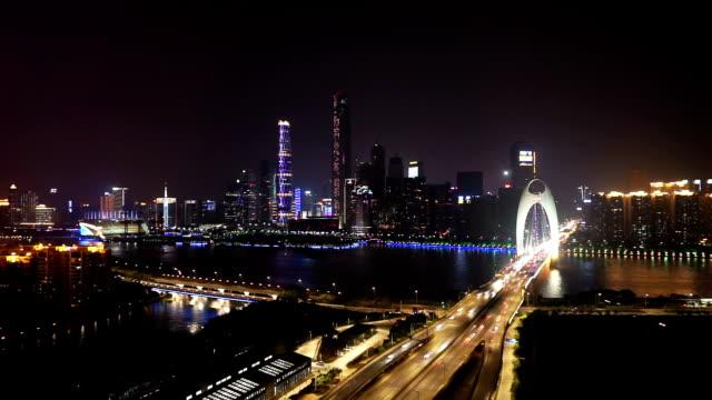 busy traffic through bridge in modern city guangzhou at night,timelapse.