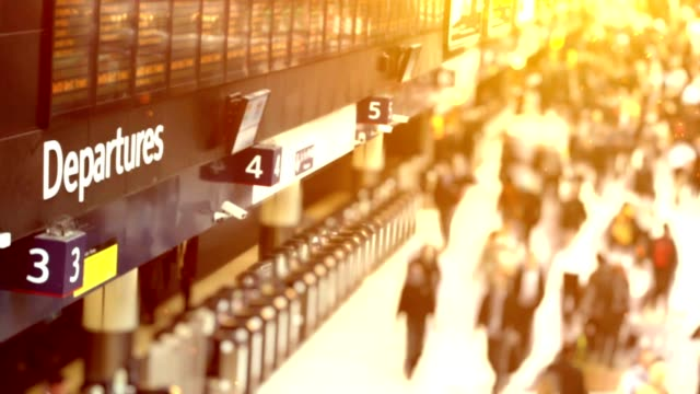 busy train station departures. hd - railway station platform stock videos & royalty-free footage