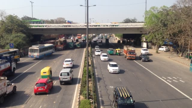 Busy vehcular traffic right on the ring road right outside the InterState Bus Terminal at Kashmiri Gate Delhi