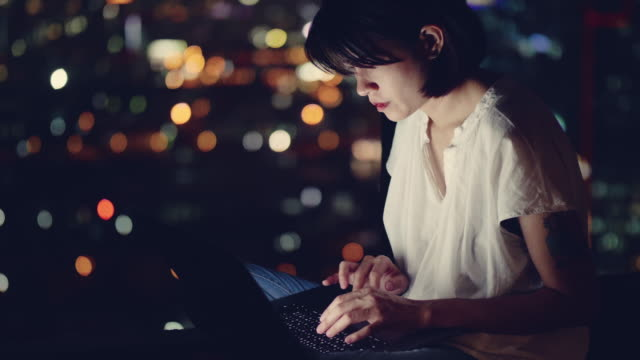 busy woman working in dark office - using laptop stock videos & royalty-free footage