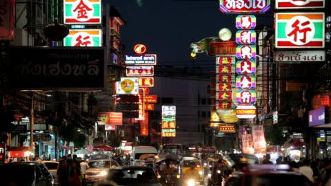 busy yaowarat road in the night - bangkok stock videos & royalty-free footage
