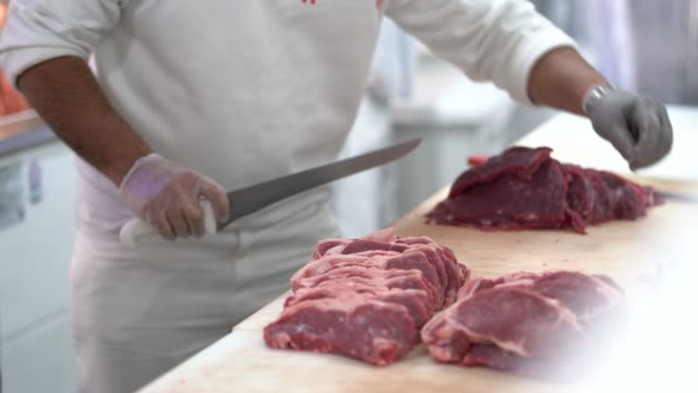 butcher meat cutter meat - meat stock videos & royalty-free footage