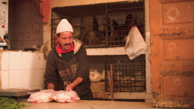 A butcher sells two chickens.