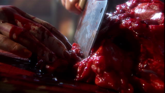 a butcher uses a cleaver to cut meat. - butcher stock videos & royalty-free footage