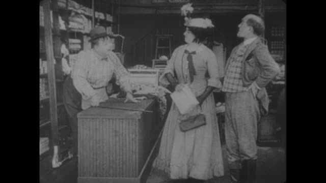 1917 butcher (fatty arbuckle) uses store pulley and ladder system to get order for ungrateful customer - spanking stock videos and b-roll footage