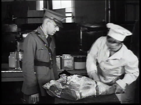 1934 MONTAGE Butcher working in kitchen as uniformed man watches / United States