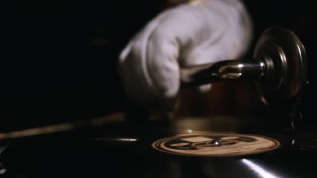 CU Butler placing gramophone / Edinburgh, Scotland, United Kingdom