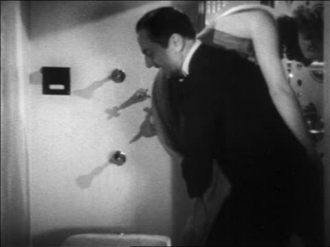 b/w 1936 butler puts sleeping woman in shower / turns it on / film - 1936 stock videos and b-roll footage
