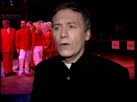 new uniforms for redcoats:; itn england: london: int new uniforms for butlin's redcoats unveiled at fashion show jeff banks interview sot - talks of... - michael barrymore stock-videos und b-roll-filmmaterial