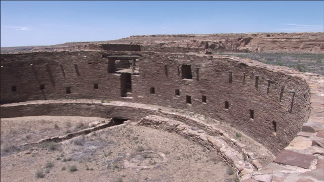 a butte overlooks chetro ketl at chaco culture national historical park. - anasazi stock videos & royalty-free footage