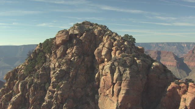 stockvideo's en b-roll-footage met ms aerial butte to reveal zuni point canyon and temples in grand canyon north rim / arizona, united states - zuni