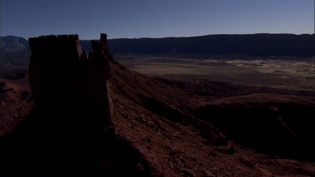 a butte towers over monument valley. - butte rocky outcrop stock videos & royalty-free footage