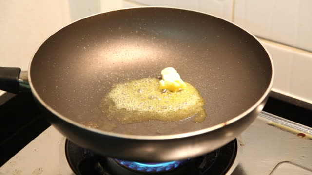 butter melting in pan - stove stock videos & royalty-free footage
