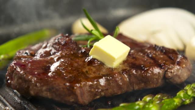 butter melting on steak / south korea - melting butter stock videos & royalty-free footage