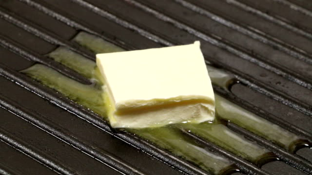 butter melting - melting butter stock videos & royalty-free footage
