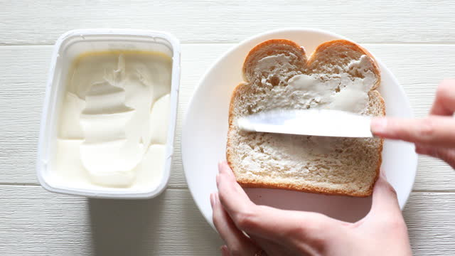butter on bread - table knife stock videos & royalty-free footage