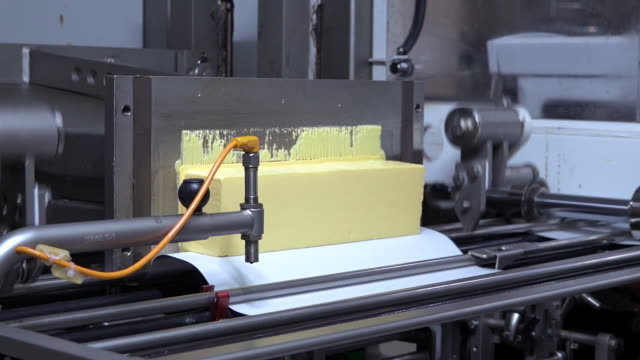 butter production factory, automated line packing.  butter wrapping machine - dairy product stock videos & royalty-free footage