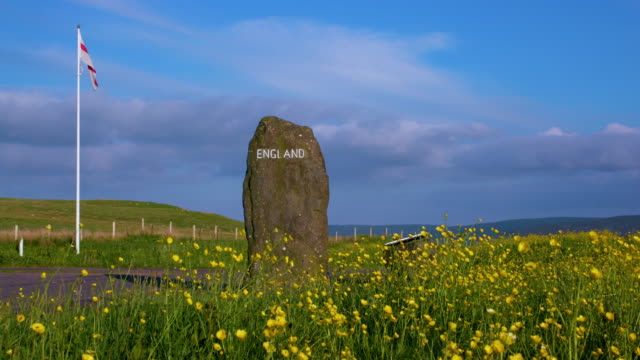 Buttercups & England Sign On Large Stone, A68 Scotland, England